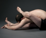 Foot behind head seated forward bend